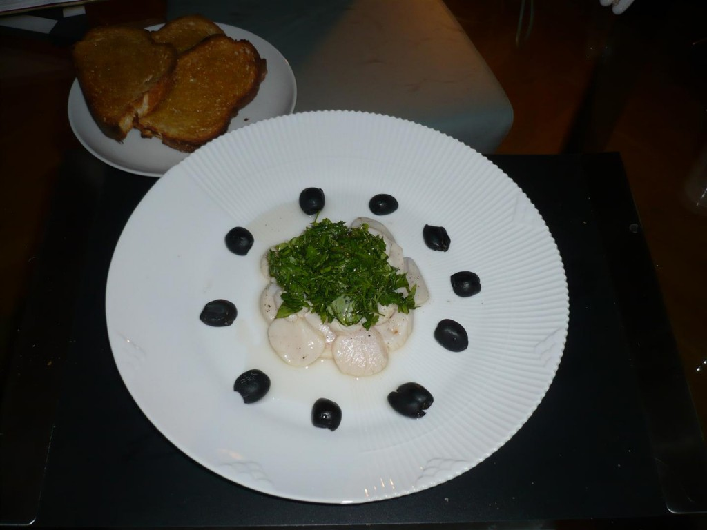 Scallop carpaccio with herbs, olives and toasted bread with olive oil (Claus Meyer)